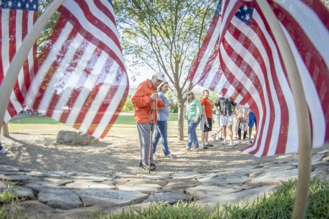 Ben Skardon through the flags