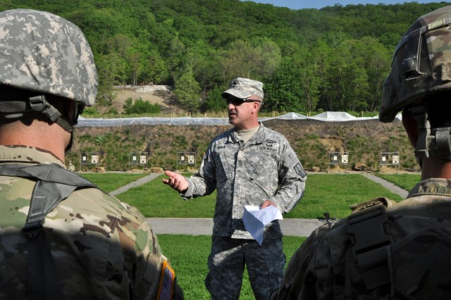 U.S. Army National Guard soldier, Master Sgt. Brian Shea from Joint Force Headquarters-N.Y., gives soldiers a safety briefing on Camp Smith, Cortlandt N.Y., May 19, 2017. Shea went over basic safety procedures on the range and checked to make sure all soldiers had protective gear on before firing their weapons.