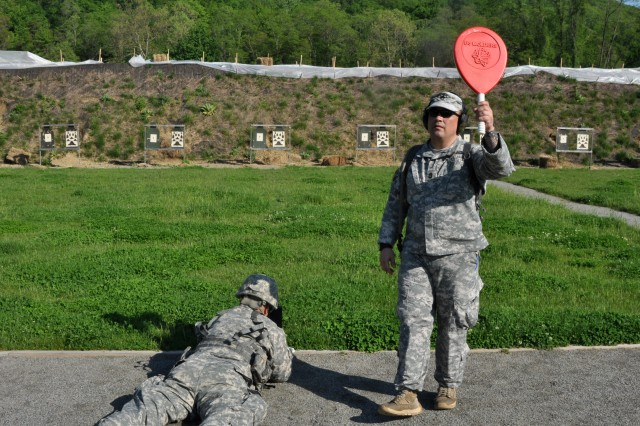 U.S. Army National Guard soldier, Sgt. 1st Class Robert Landry from Joint Force Headquarters-N.Y., calls for the attention of the tower on an M4 range on Camp Smith, Cortlandt N.Y., May 19, 2017. Landry needed to give a soldier more time to shoot because he had an extra round in the magazine of his M4.