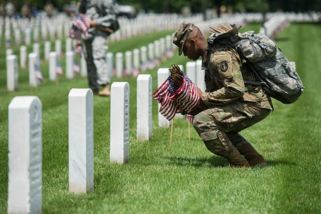 Members of the 3rd U.S. Infantry Regiment, also known as the Old Guard, participate in the annual Flag-In at Arlington National Cemetery, Thursday, May 25, 2017, in Arlington, Va.