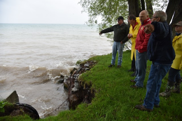 On a site visit to Wilson, New York town officials pointed out a shore protection wall eroding due to high water levels and waves.  A US Army Corps of Engineers, Buffalo District technical field team visit the site in support of New York Lake Ontario flood operations.