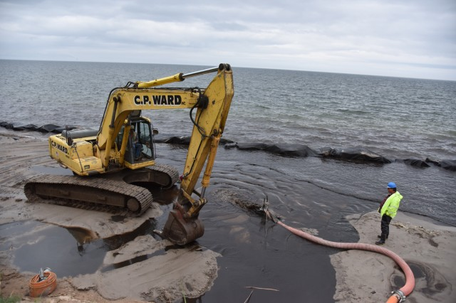 Sandy Island Beach State Park officials showed a USACE, Buffalo District technical field team current flood operation efforts to save the eroding shoreline and sand dunes.