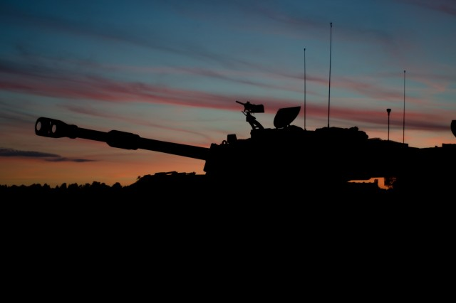 An M109A6 Paladin with Bravo Battery, 3rd Battalion, 29th Field Artillery Regiment (Pacesetters), 3rd Armored Brigade Combat Team, 4th Infantry Division waits for darkness before the night live-fire portion of the table six gunnery certification May 25, 2017 at Camp Karliki Range, Poland. Training in Europe, with Allies, or training as a unit on NATO soil provides a unique opportunity to hone in skills and retains the ability to integrate indirect fires during future combined arms exercises. (U.S. Army photo by Capt. John W. Strickland)