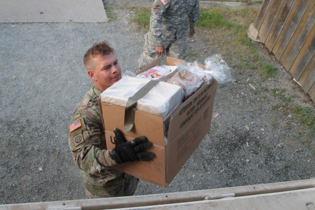 Sgt. William Deschenes of Company H, 2nd Battalion, 12th Infantry Regiment, 2nd Infantry Brigade Combat Team, 4th Infantry Division pulls a box of food off a LMTV (light-medium tactical vehicle) during his morning supply run to one of the ranges at Grafenwoehr Training Area, Germany on May 29, 2017. Deschenes and the other soldiers of Company H are tasked with seeing that the soldiers of 2-12th are fed properly to keep them an effective fighting force. Speed is essential as all soldiers work tirelessly to ensure the success of this emergency deployment readiness exercise, an Army initiative that looks to ensure units can deploy on short notice to anywhere in the world. (Photo taken by Pvt. Nicholas Vidro, 7th Mobile Public Affairs Detachment.)