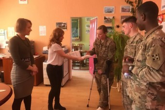 3-29 FA Soldiers befriend Polish children during school visits