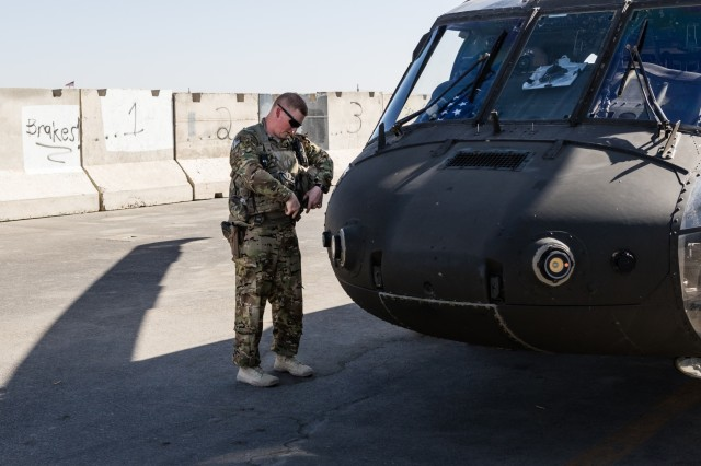 A U.S. Army UH-60 Black Hawk helicopter pilot assigned to Task Force Warhawk, 16th Combat Aviation Brigade, 7th Infantry Division prepares for a flight at Kandahar Airfield, Afghanistan, May 27, 2017. The Warhawks are working hard to support U.S. Forces Afghanistan as part of Operation Freedom's Sentinel and Resolute Support Mission.