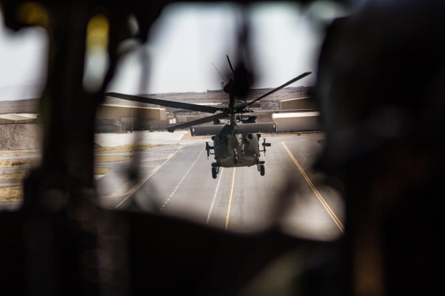 U.S. Army UH-60 Black Hawk helicopters pilots assigned to Task Force Warhawk, 16th Combat Aviation Brigade, 7th Infantry Division depart for a flight at Kandahar Airfield, Afghanistan, May 27, 2017. The Warhawks are working hard to support U.S. Forces Afghanistan as part of Operation Freedom's Sentinel and Resolute Support Mission.