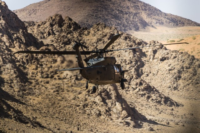 U.S. Army UH-60 Black Hawk helicopter pilots assigned to Task Force Warhawk, 16th Combat Aviation Brigade, 7th Infantry Division fly near Kandahar Airfield, Afghanistan, May 27, 2017. The Warhawks are working hard to support U.S. Forces Afghanistan as part of Operation Freedom's Sentinel and Resolute Support Mission.