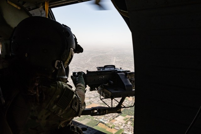 A U.S. Army UH-60 Black Hawk helicopter crew chief assigned to Task Force Warhawk, 16th Combat Aviation Brigade, 7th Infantry Division scans her sector during a mission near Kandahar Airfield, Afghanistan, May 27, 2017. The Warhawks are working hard to support U.S. Forces Afghanistan as part of Operation Freedom's Sentinel and Resolute Support Mission.