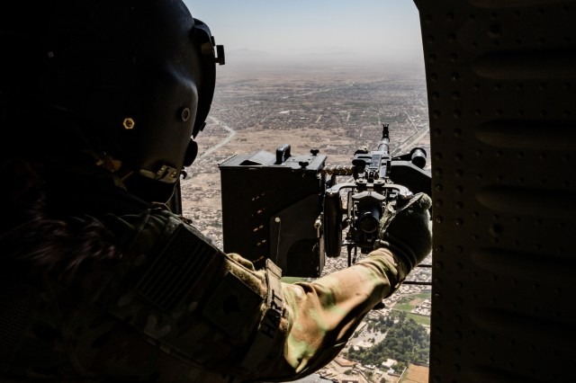 A U.S. Army UH-60 Black Hawk helicopter crew chief assigned to Task Force Warhawk, 16th Combat Aviation Brigade, 7th Infantry Division scans her sector during a flight near Kandahar Airfield, Afghanistan, May 27, 2017. The Warhawks are working hard to support U.S. Forces Afghanistan as part of Operation Freedom's Sentinel and Resolute Support Mission.