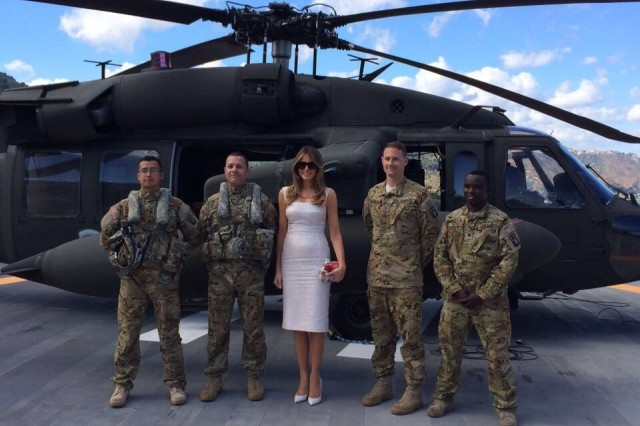 Soldiers from Alpha Company, 1st Bn., 214th Avn. Regt., 12th Combat Aviation Brigade pose with the First Lady of the United States on 26 May, 2017, near Sigonella Naval Air Station (NAS), Sicily during her visit to the 43rd G7 Summit in Taormina. The 1st Bn., 214th Avn. Regt., conducted air movements in support of the President of the United States (POTUS),(FLOTUS), Senior White House staff, and security personnel during the 43rd G7 Summit.
