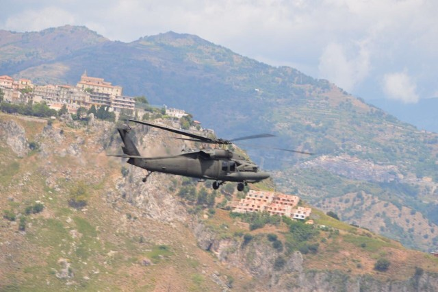 A UH-60 Black Hawk Helicopter from 1st Bn., 214th Avn. Regt., General Support Aviation (GSAB), 12th Combat Aviation Brigade transports the First Lady of the United States (FLOTUS) on 26 May, 2017, near Sigonella Naval Air Station (NAS), Sicily during her visit to the 43rd G7 Summit in Taormina.