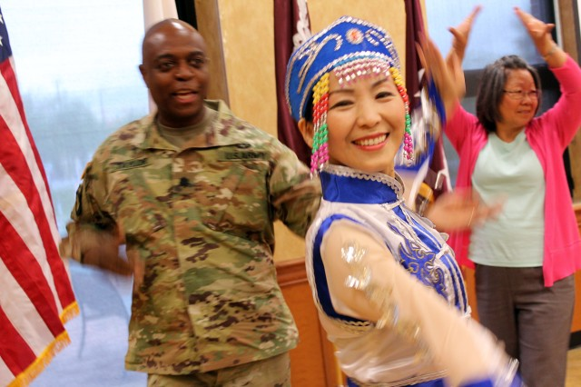 Soldiers on Fort Detrick, Maryland, received free dance lessons from performers from the Chinese Culture and Community Service Center during an Asian American and Pacific Islander Heritage Month celebration on post May 25.