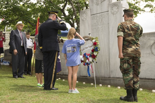 "Maj. Gen. Stephen Farmen, commander of the U.S. Army Security Assistance Command, placed the Gold Star Families wreath along with the children of Cpt. Waid ""Chip"" Ramsey during Huntsville's Memorial Day ceremony held May 29, 2017 at Maple Hill Cemetery."