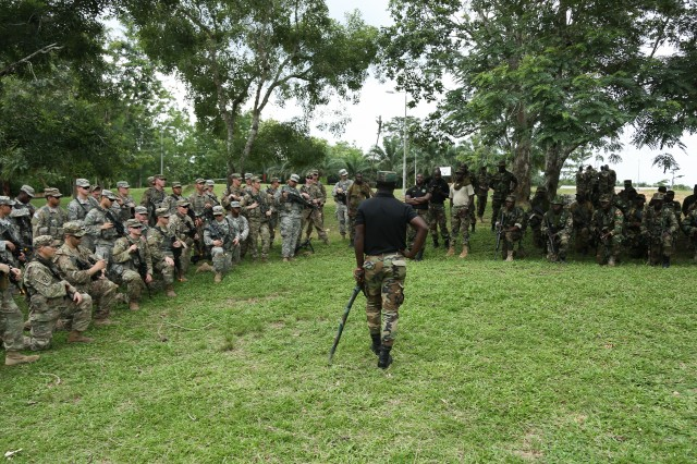 Ghana Armed Forces Maj. Jacob Codjoe, course commander of the Jungle Warfare School, gives a brief to U.S. Soldiers assigned to the 1st Battalion, 506th Infantry Regiment, 1st Brigade Combat Team, 101st Airborne Division during United Accord 2017 on Achiase military base in Akim Oda, Ghana on May 20, 2017. The Jungle Warfare School is a series of situational training exercises designed to train participants in counter-insurgency and internal security operations.