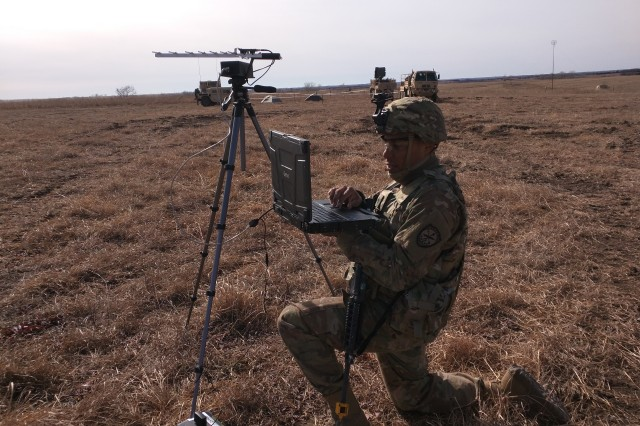 Staff Sgt. Isaias Laureano, a member of the Expeditionary CEMA (Cyber Electromagnetic Activities) Team, 781st Military Intelligence Battalion, conducts cyberspace operations while supporting the 2nd Armored Brigade Combat Team, 1st Infantry Division, during their Danger Focus Field Training Exercise at Fort Riley, Kansas, in early Feb.