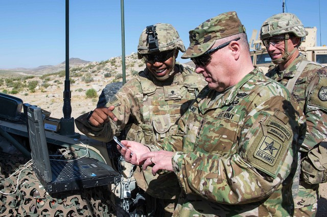 U.S. Army Chief of Staff Gen. Mark A. Milley listens to a briefing from Spc. Steven McAdoo (left), Expeditionary CEMA (Cyber Electromagnetic Activities) Team (ECT), 781st Military Intelligence Battalion, during a visit to the National Training Center at Fort Irwin, California, May 9, 2017. The ECT Soldiers are members of the U.S. Army Cyber Command's CEMA Support to Corps and Below (CSCB) Cell, and were conducting cyberspace operations in support of a training rotation by the 2nd Armored Brigade Combat Team, 1st Infantry Division, as part of the ARCYBER-led CSCB initiative to help the Army define expeditionary cyber capabilities and their integration into maneuver unit planning processes.