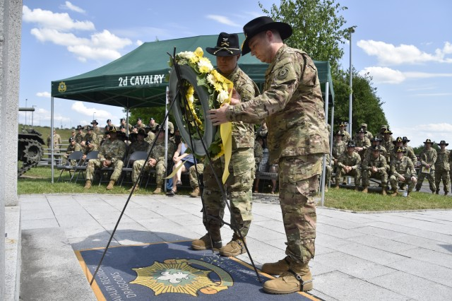U.S. Soldiers assigned to 2d Cavalry Regiment participate in a memorial ceremony at Rose Barracks, Germany, May 30, 2017.