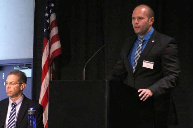 Brian Knutson, procuring contracting officer, Army Contracting Command-Rock Island speaks about the acquisition strategy for the Logistics Civil Augmentation Program, at the iWireless Center, Moline, Illinois, May 23. (Photo by Liz Greenawalt, ACC-RI Public Affairs)