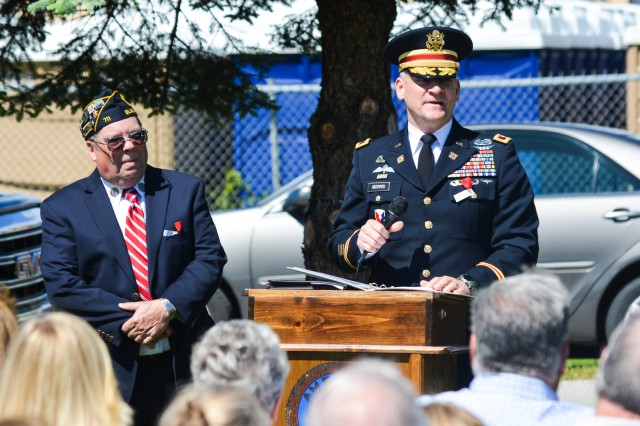 Col. Grant Morris, director of operations, U.S. Army Sustainment Command, serves as the guest speaker for the American Legion Post 711's Memorial Day service at Blue Grass Cemetery, May 29.