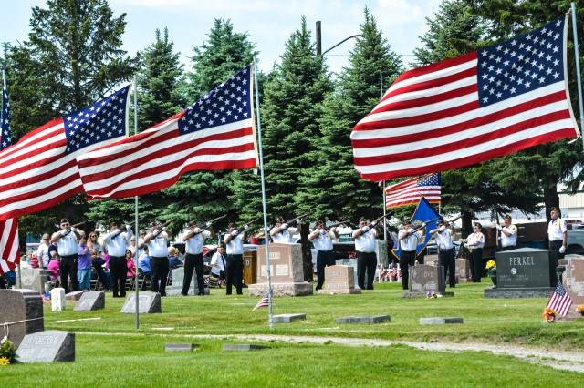 The American Legion Post 711 fires a 21-gun salute during their Memorial Day service at Blue Grass Cemetery in Blue Grass, Iowa, May 29.