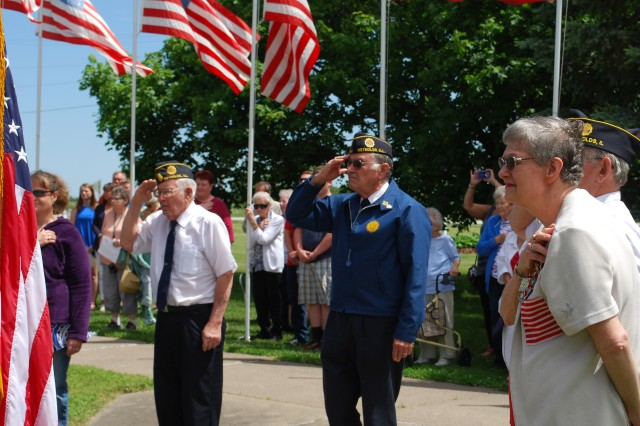 Members of the American Legion Post 1166 salute the American flag during their annual Memorial Day service in Reynolds, Illinois, May 29.