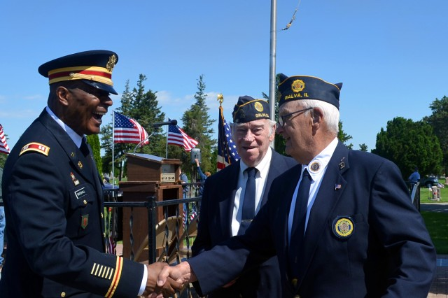 Capt. James Marshall, operations battle captain, U.S. Army Sustainment Command, shakes the hand of Lloyd Anderson, a member of the Galva American Legion Hagberg-Hamlin 45, in Galva, Illinois, May 29.