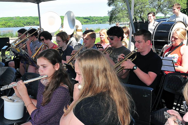 The Riverdale High School band plays a medley of patriotic songs during the Memorial Day ceremony May 29 at Port Byron, Illinois.