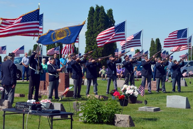 The Galva American Legion Hagberg-Hamlin 45 fire a 21-gun salute during their Memorial Day event in Galva, Illinois, May 29.
