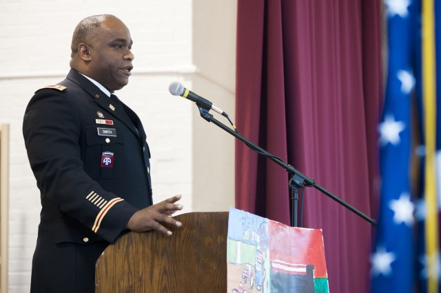 Lt. Col. Rodney Smith from the U.S. Army Sustainment Command speaks to an audience of more than 120 people during a Memorial Day remembrance ceremony at the Cambridge Community Hall in the Village of Cambridge, Illinois, May 29.