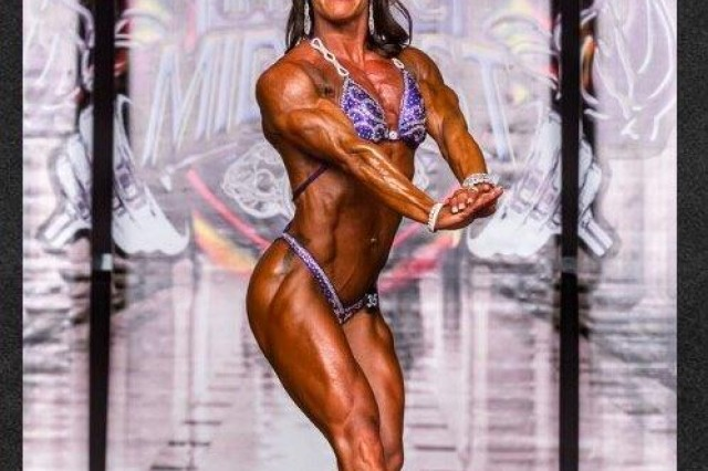 Amanda Slinker, an RN at IRAHC, poses during the St. Louis Pro Bodybuilding show held in April in St. Louis. She received a top five placing.
