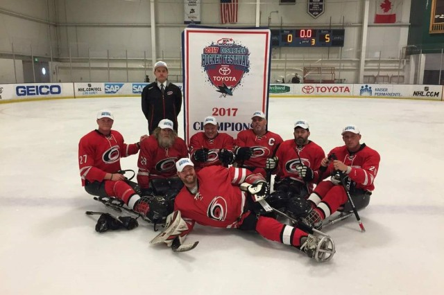 Staff Sgt. Gary Smith (far right) and his teammates celebrate their National 2017 Disabled Hockey Festival win