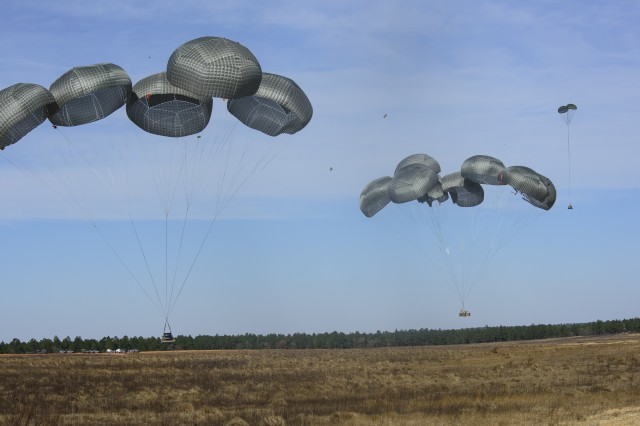 The Advanced Low Velocity Airdrop System - Light/Heavy (ALVADS-L/H) delivers the Advance Aviation Forward Area Refueling Systems (AAFARS) (left) and a High Mobility Engineering Equipment (HMEE) vehicle (right) to ground troops and is nearly at its half-way point in operational testing with the Fort Hood, Texas-based U.S. Army Operational Test Command's Airborne and Special Operations Test Directorate (ABNSOTD) at Fort Bragg, North Carolina.