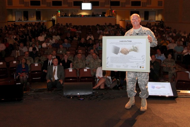 Lt. Gen. Kenneth R. Dahl displays the signed U.S. Army Installation Management Command Leadership pledge in front of the IMCOM headquarters staff May 31, 2017 during an IMCOM HQ town hall meeting at the Fort Sam Houston theater.