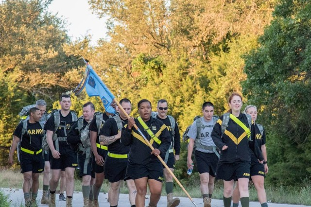 Soldiers of the Headquarters and Headquarters Detachment, 163rd MI Battalion, 504th Military Intelligence Brigade conduct the 'Carry the Load' ruck march with name plates of Soldiers who have given the ultimate sacrifice attached to their rucks at West Fort Hood.