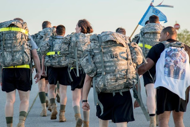 Headquarters and Headquarters Detachment, 163rd MI Battalion Soldiers carry the load for fallen service members and comrades as they ruck march around the West Fort Hood PT Track, May 24, 2017.