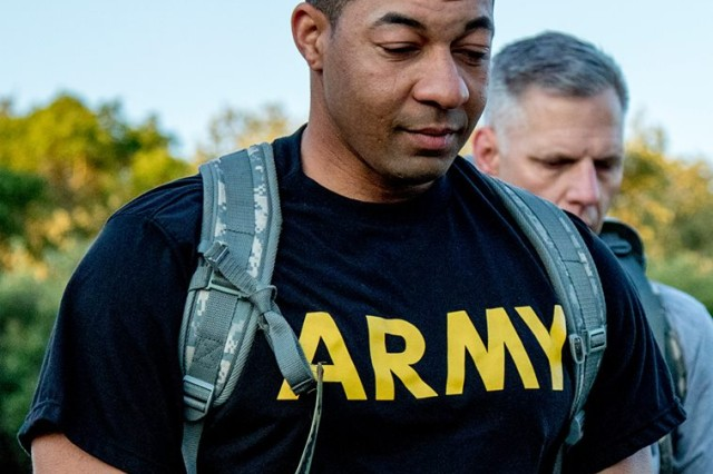Sgt. 1st Class Jonathan Risher reflects on fallen service members during the 'Carry the Load' ruck march on West Fort Hood.