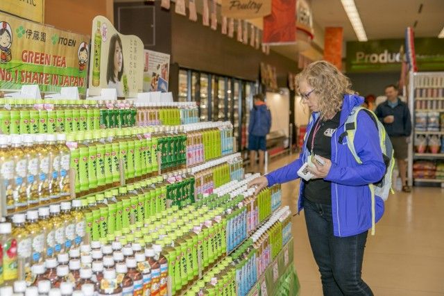 Noelle Austin-Jones, Army Wellness Center health technician, browses the new tea display in the Sagamihara Family Housing Area Commissary during the Healthy Lifestyles event held May 26, 2017. (U.S. Army photo by Honey Nixon)