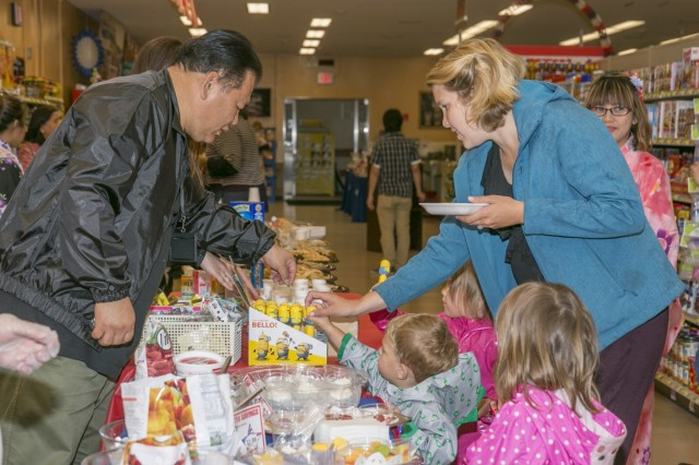 Customers gather around a healthy food display during the Healthy Lifestyles event held May 26, 2017 at Sagamihara Family Housing Area Commissary. (U.S. Army photo by Honey Nixon)