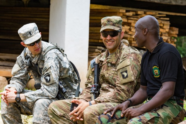 U.S. Soldiers assigned to 1st Battalion, 506th Infantry Regiment, 1st Brigade Combat Team, 101st Airborne Division discuss raid techniques with a Ghanian Armed Forces instructor during United Accord 2017 at the Jungle Warfare School in Achiase military base, Akim Oda, Ghana, May 20, 2017. The Jungle Warfare School is a series of situational training exercises designed to train participants in counter-insurgency and internal security operations. (U.S. Army photo by Spc. Victor Perez Vargas)