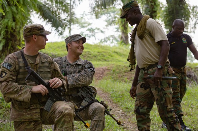Ghana Armed Forces Sgt. M Agyemang discusses training with U.S. Soldiers from 1st Battalion, 506th Infantry Regiment, 1st Brigade Combat Team, 101st Airborne Division during United Accord 2017 at the Jungle Warfare School in Achiase military base, Akim Oda, Ghana, May 20, 2017. The Jungle Warfare School is a series of situational training exercises designed to train participants in counter-insurgency and internal security operations. (U.S. Army photo by Spc. Victor Perez Vargas)