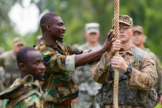 Ghanaian Armed Forces Cpl. Kingsley Anyeala explains rope climbing techniques to U.S. Army Spc. Jake Burley from the 1st Battalion, 506th Infantry Regiment, 1st Brigade Combat Team, 101st Airborne Division during United Accord 2017 at the Jungle Warfare School in Achiase military base, Akim Oda, Ghana, May 20, 2017. The Jungle Warfare School is a series of situational training exercises designed to train participants in counter-insurgency and internal security operations. (U.S. Army photo by Spc. Victor Perez Vargas)