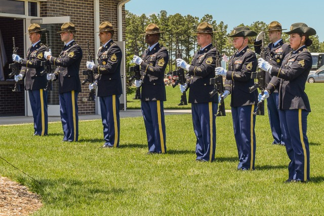 A rifle detail from the 1st Engineer Brigade salutes the fallen after firing volleys during the 2017 Memorial Day ceremony at Missouri Veterans Cemetery.