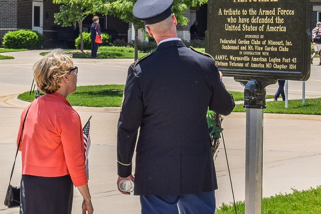 Command Sgt. Maj. Jon Stanley, Maneuver Support Center of Excellence and Fort Leonard Wood command sergeant major, and his wife Barbara, read the Blue Star Memorial plaque located at the Missouri Veterans Cemetery - Fort Leonard Wood.