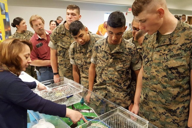 Megan Terry of the National Weather Service conducts a flood demonstration for a group of Marines at the Fort Leonard Wood Safety and Health Fair May 25 at Nutter Field House.