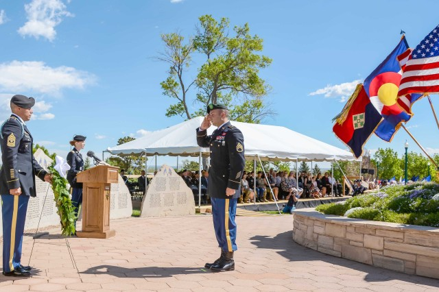 FORT CARSON, Colorado -- A 10th Special Forces Group (Airborne) Green Beret honors Staff Sgt. Adam S. Thomas during the Mountain Post Warrior Memorial Ceremony at Kit Carson Park May 25, 2017.