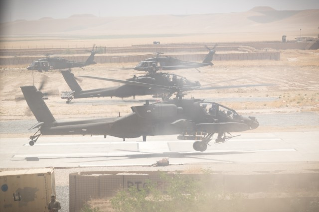 U.S. Army AH-64E Apache pilots assigned to Task Force Griffin, 16th Combat Aviation Brigade, 7th Infantry Division prepare to depart for a mission in Kunduz, Afghanistan, May 31, 2017. The Griffins are working hard to support U.S. Forces Afghanistan as part of Operation Freedom's Sentinel and Resolute Support Mission.