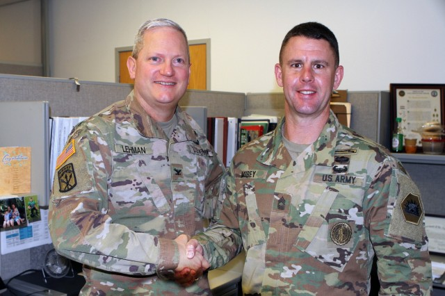 Master Sgt. Brandon S. Morey, right, assistant inspector general at the California National Guard's Inspector General's Office, is congratulated by Col. Robert J. Lehman, State Inspector General, May 12 after earning runner-up in the prestigious Dept. of the Army Inspector General Noncommissioned Officer of the Year competition recently. Morey, of Dixon, California, took top honors in April's National Guard Bureau Inspector General Soldier of the Year to earn the shot at the U.S. Army contest.