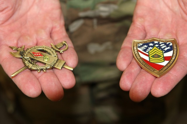 The hands of Master Sgt. Brandon S. Morey, assistant inspector general at the California National Guard's Inspector General's Office, display the coins earned during April's National Guard Inspector General Noncommissioned Officer of the Year competition, where he earned top honors.