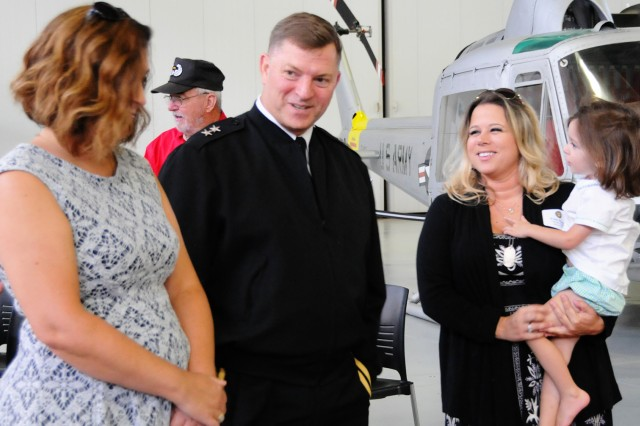 Kristy Stanley, Gold Star Family member, and her daughter, Destry, speak with Maj. Gen. William K. Gayler, U.S. Army Aviation Center of Excellence and Fort Rucker commanding general, and his wife, Michele, during the Survivor Outreach Services Gold Star Family reception at the U.S. Army Aviation Museum May 26.